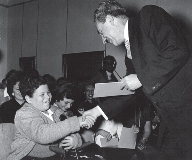 Young Itzhak Perlman receiving the Sharett Scholarship, which provides tuition assistance to young students in Israel.