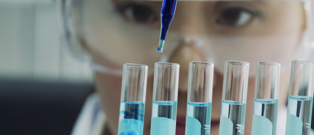 Researcher testing liquids in vials with a dropper for research of the brain.