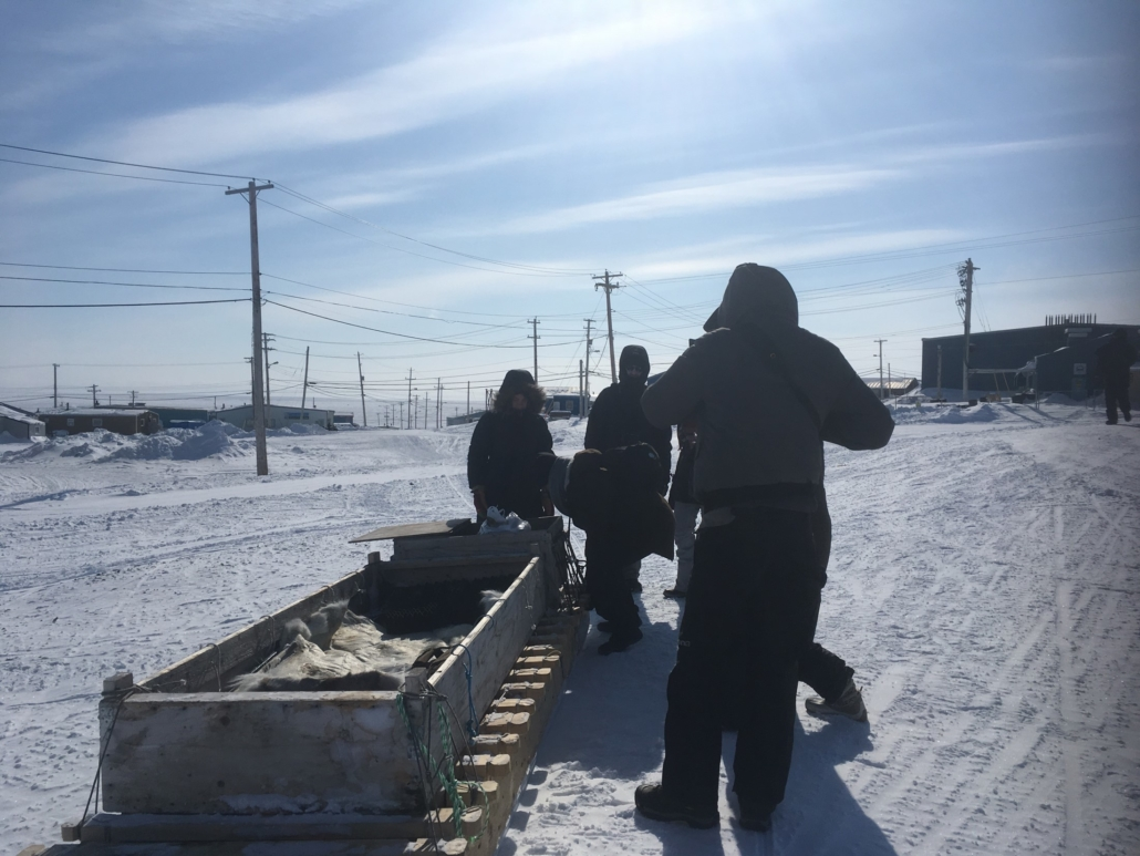 Carleton students work with a sledge in Iglulik, Nunavut as part of the Azrieli Global Studio.