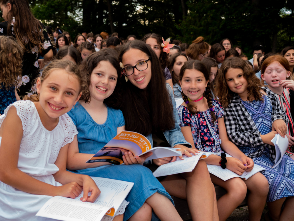 Camp Ramah students reading, learning about the Jewish culture is part of their experience.