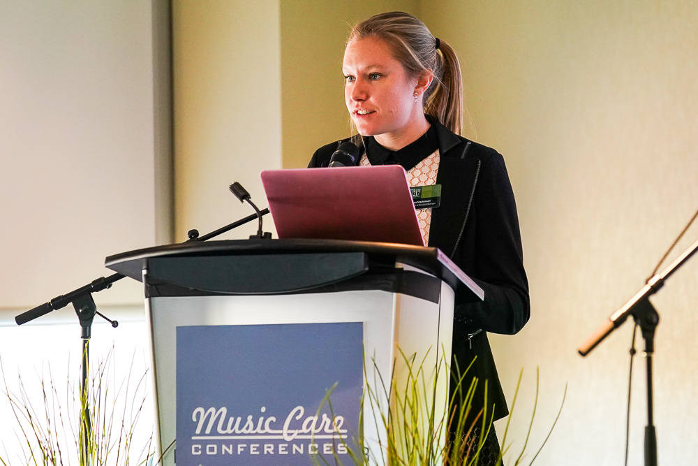 Chelsea Mackinnon, education and research lead, presenting at a music care conference in the UK.