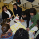 Darca Schools people workingaround a table